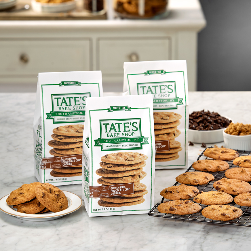 Bags of cookies and rack of cookies on a counter