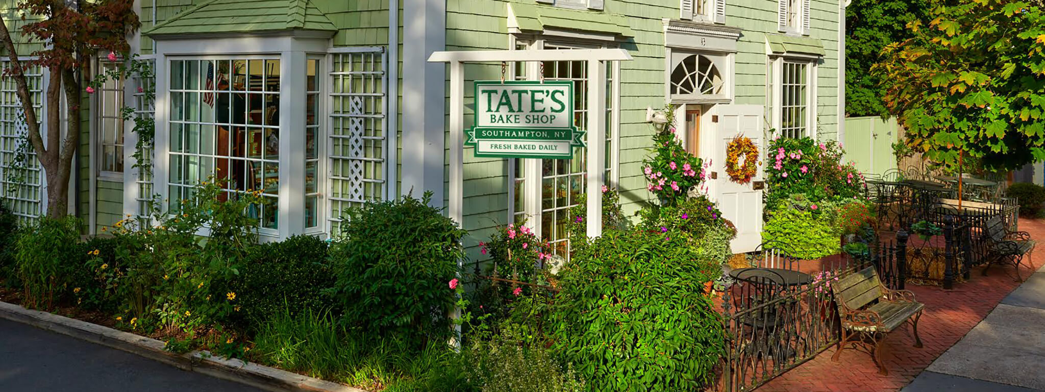 Tate's Bake Shop in sunshine with garden